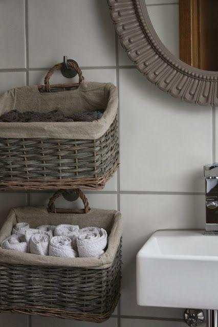 симпатичные корзиночки под полотенца в ванной комнате фото